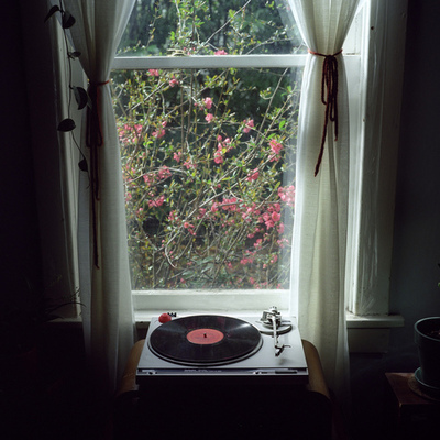 Recor player in front of window