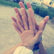 Hands of couple and child
