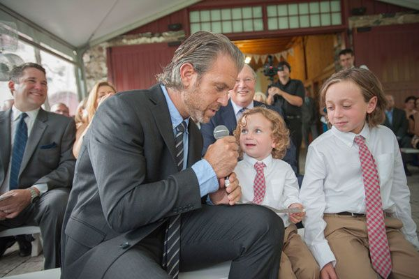 Father reading vows to children