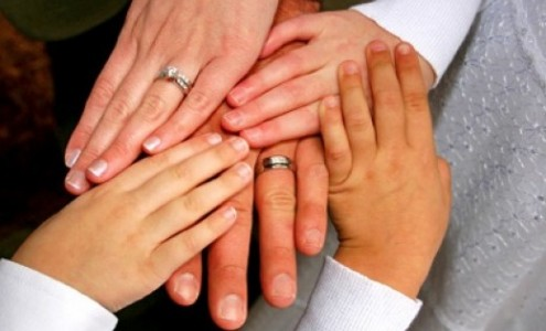 Bride, Groom and children's hands
