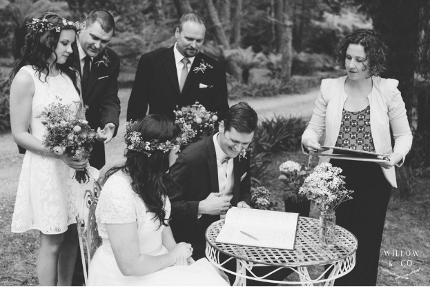 Megan-and-Marc-Blue-Mountains-wedding-signing-the-register-with-celebrant-Andrea-Calodolce
