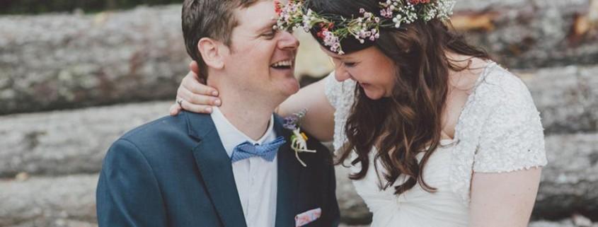 Bride sitting on Groom's lap floral headpiece