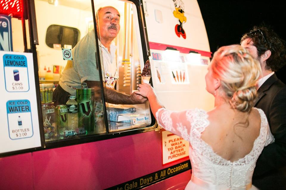 Bride getting ice cream from mr whippy truck