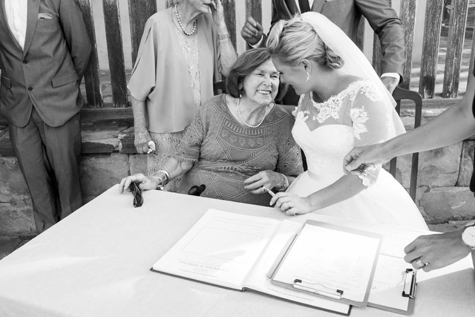 Bride with grandmother signing marriage certificate