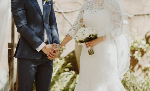 Bride and Groom hold hands during their wedding ceremony - Andrea Calodolce Ceremonies - Sydney Celebrant