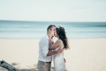 Couple kiss during beach ceremony Andrea Calodolce Marriage Celebrant Sydney