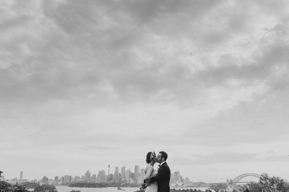 Bride and Groom sharing a kiss overlooking Sydney Harbour | Andrea Calodolce Marriage Celebrant Sydney