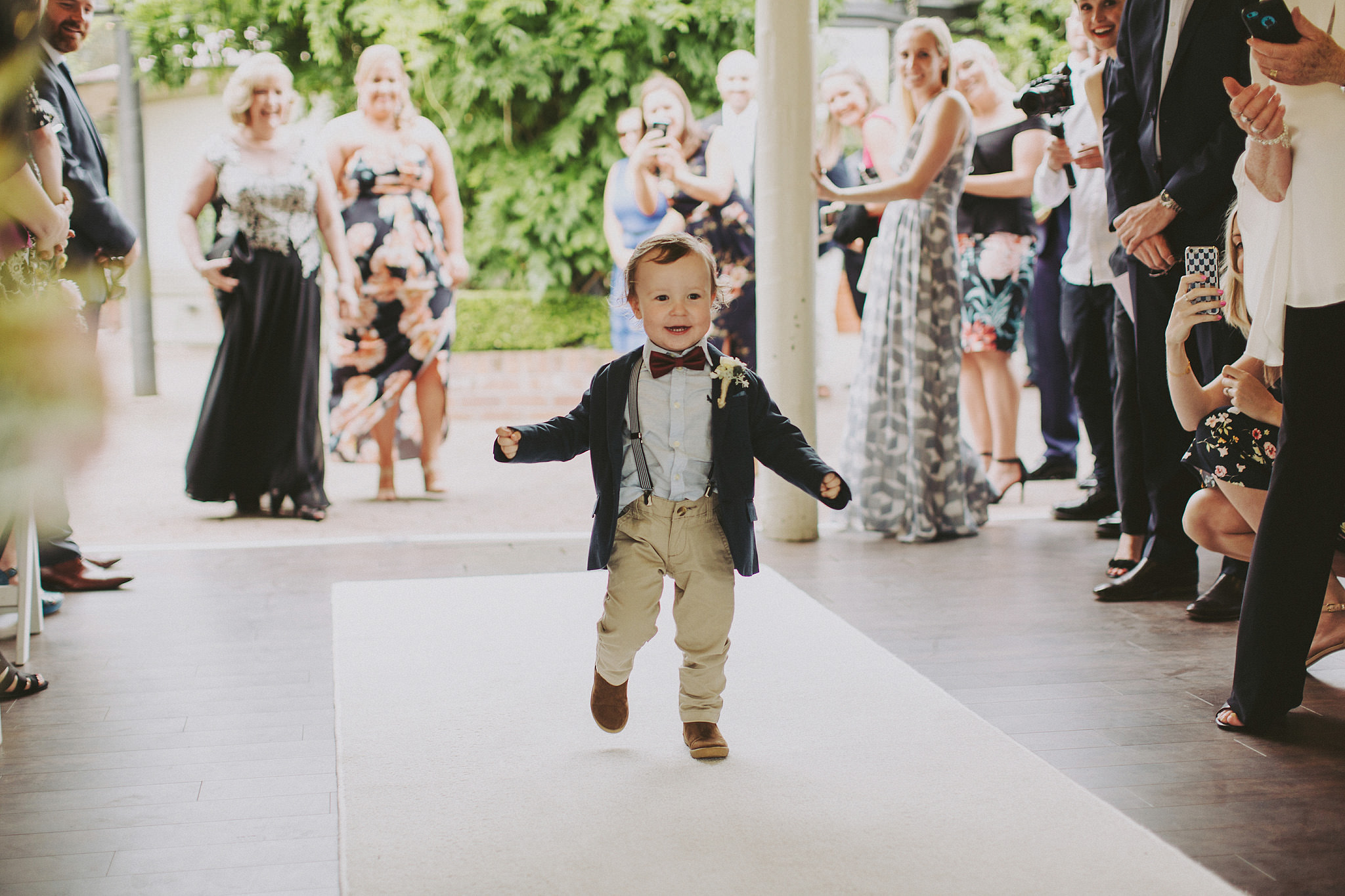Little boy running down the aisle at wedding | Andrea Calodolce Marriage Celebrant