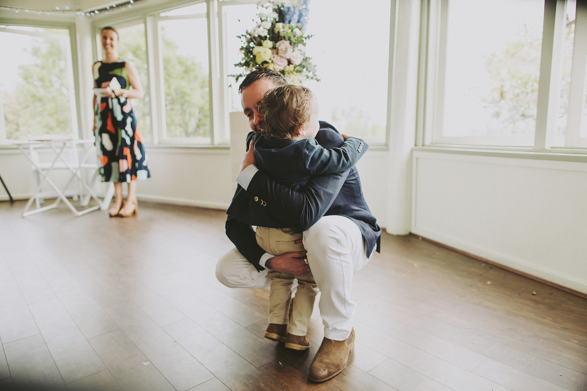 Little boy hugging his dad, the groom at wedding | Andrea Calodolce marriage celebrant sydney