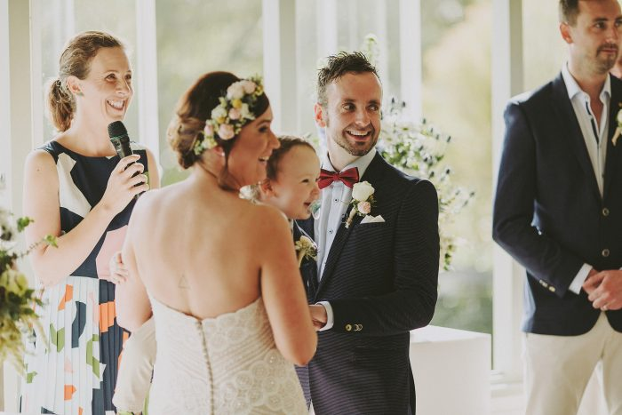 Bride holding child with groom and marriage celebrant Andrea Calodolce