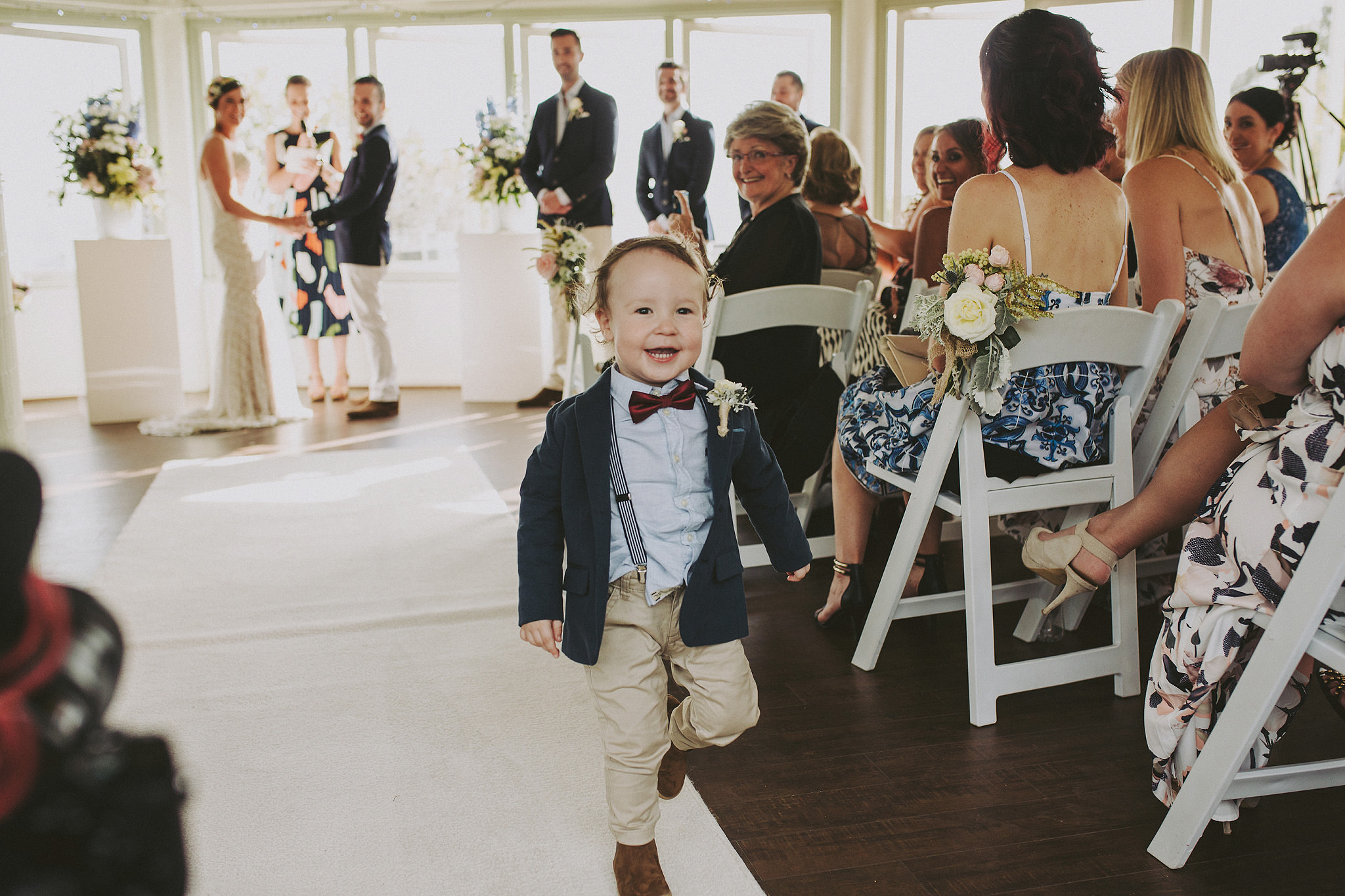 Little boy running down aisle at his parents wedding | Andrea Calodolce marriage celebrant sydney