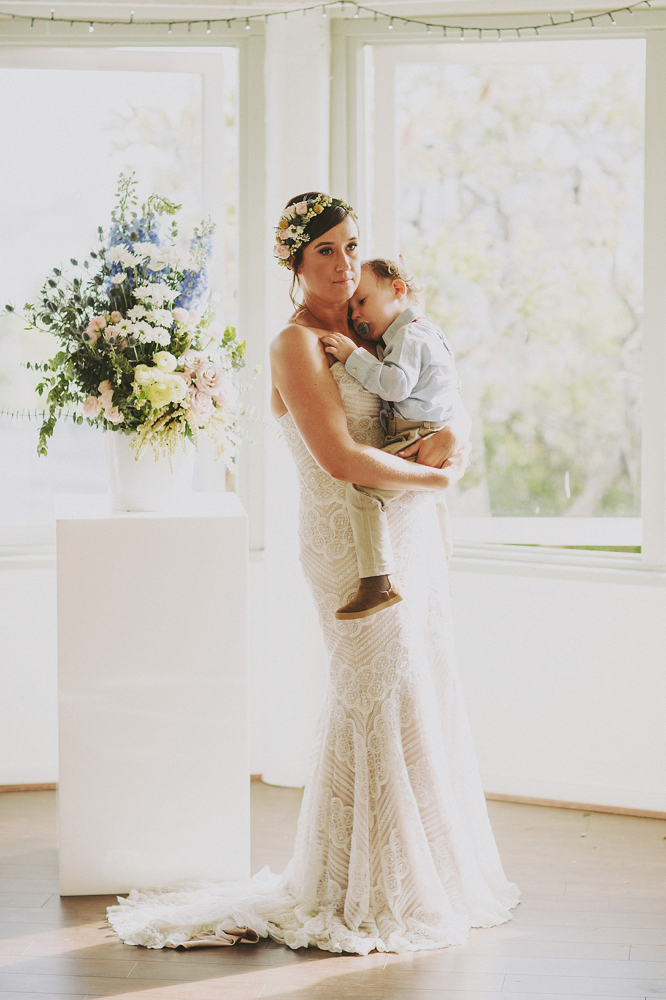 Beautiful bride holding son during ceremony | Andrea Calodolce marriage celebrant sydney